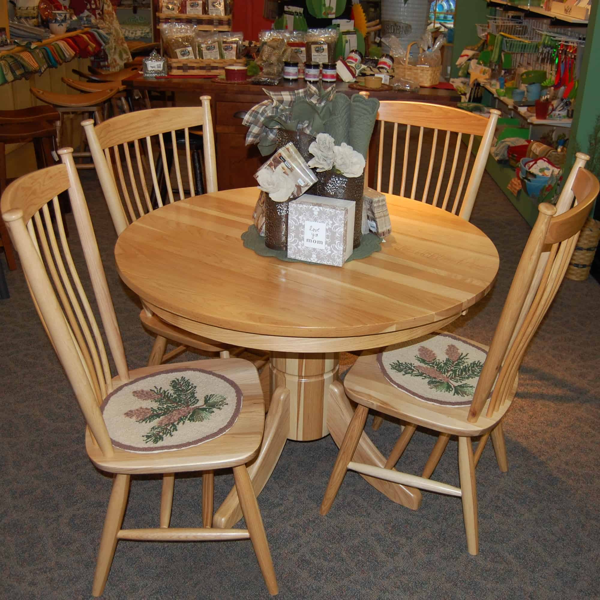 "42"" round tribeca hickory dining table, shown in hickory with a"