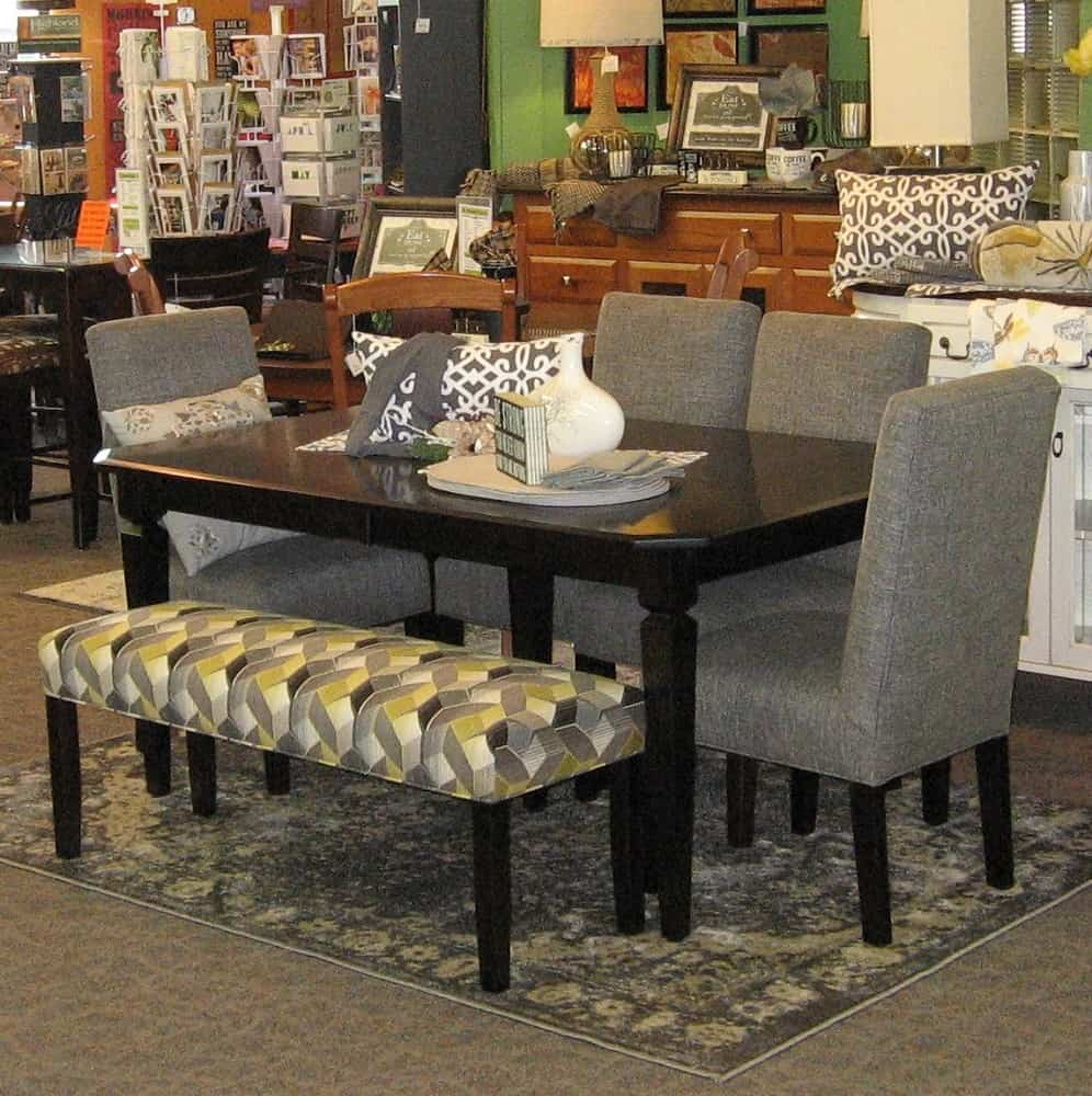 42 X 66 Weston Dining Table With 2 12 Leaves Set Includes 4 Charmer Fabric Covered Side Chairs And A Bench Shown In Brown