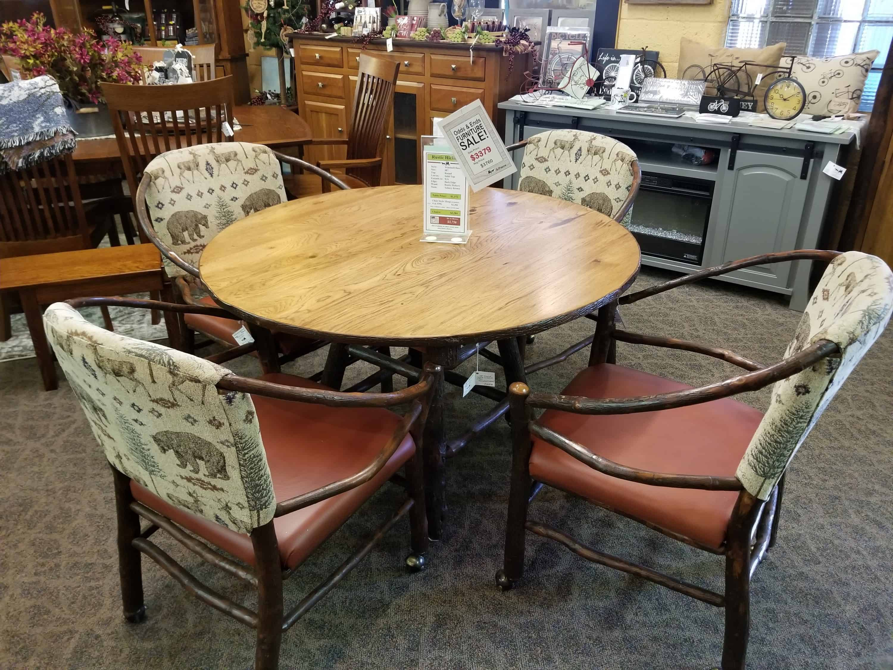 Round log table set with 4 hoop chairs with castors