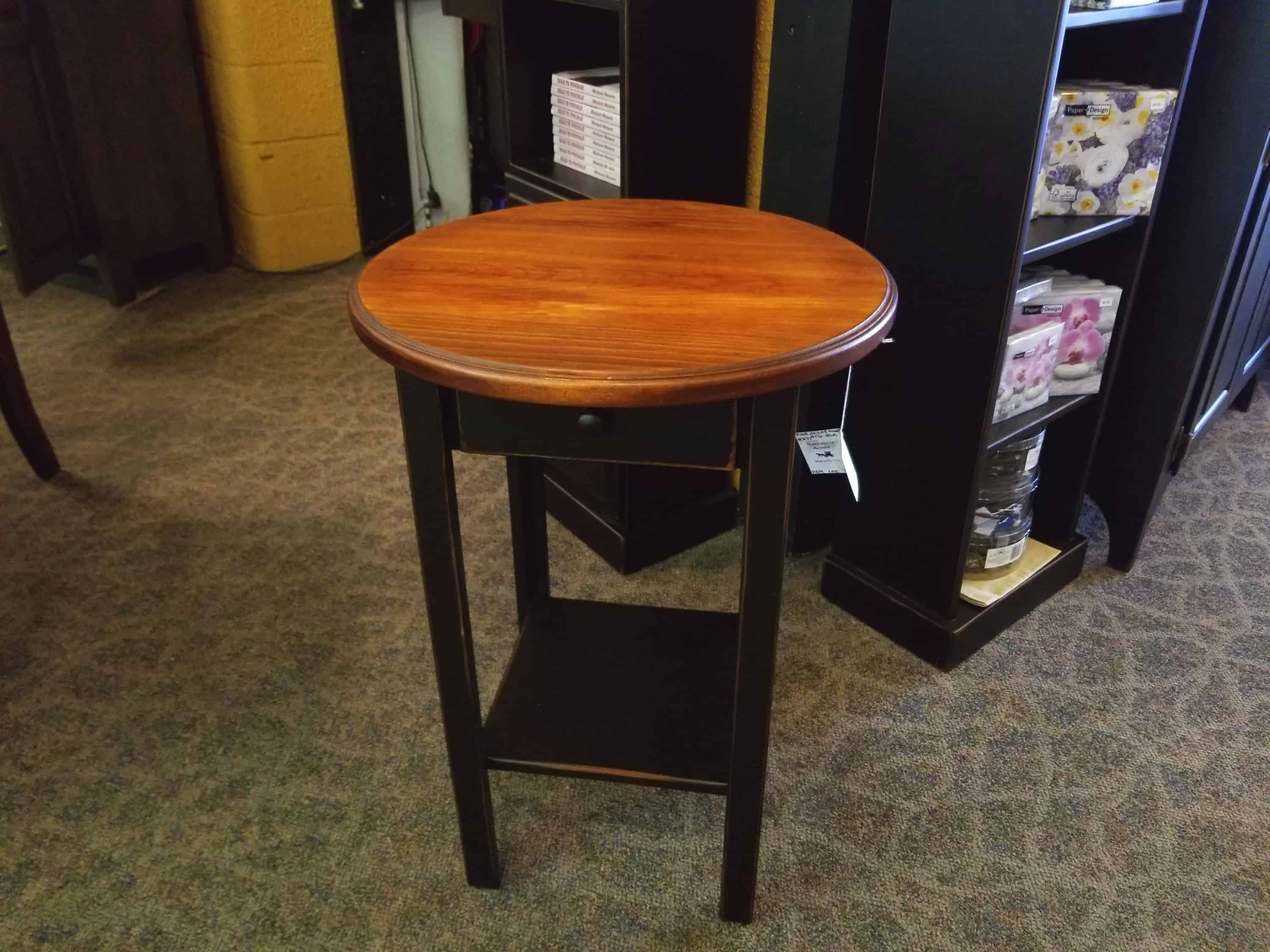 Round End Table Shown In Pine With A Two Tone Black