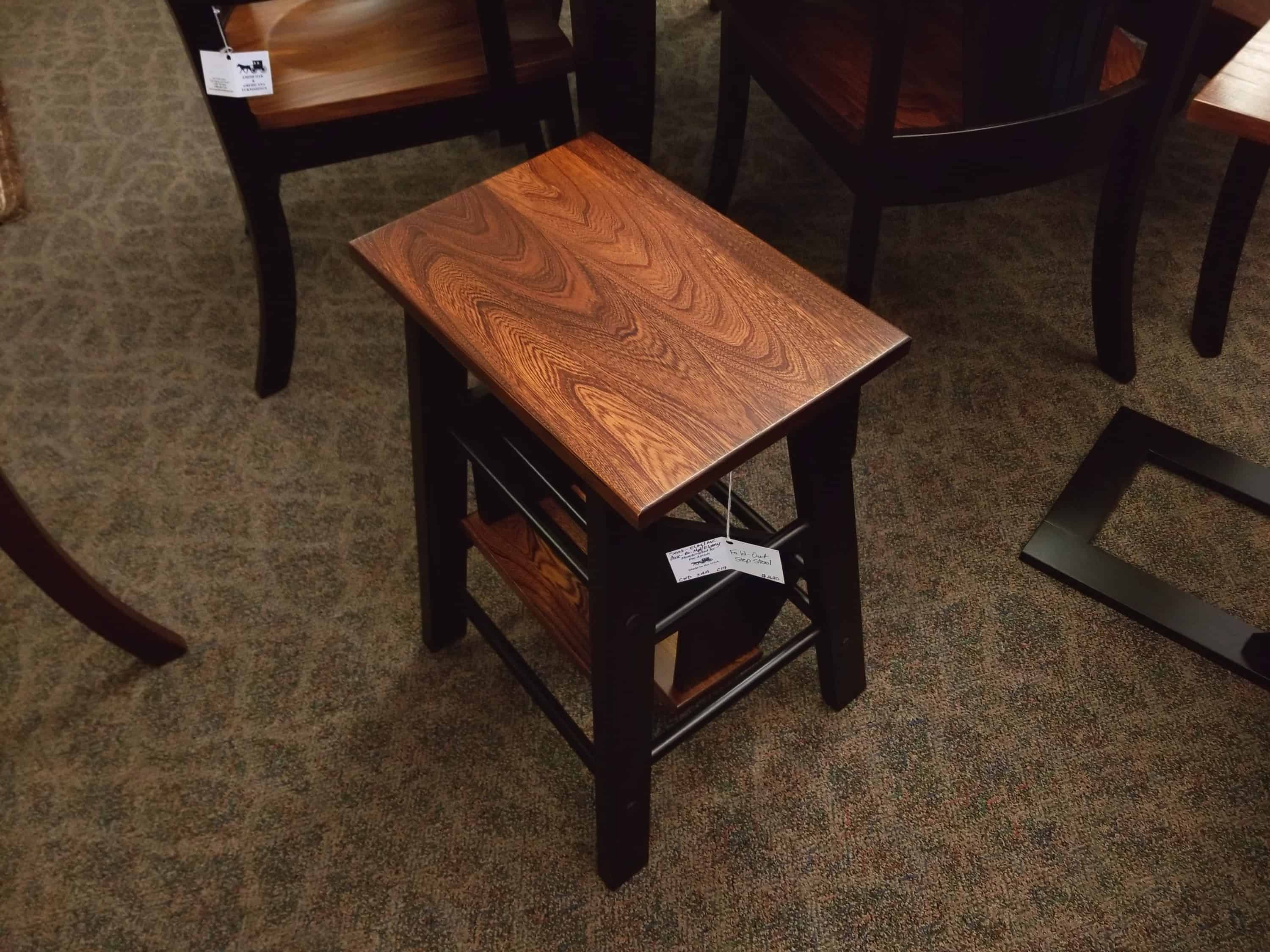 Fold Out Step Stool Shown In A Two Tone Brown Maple
